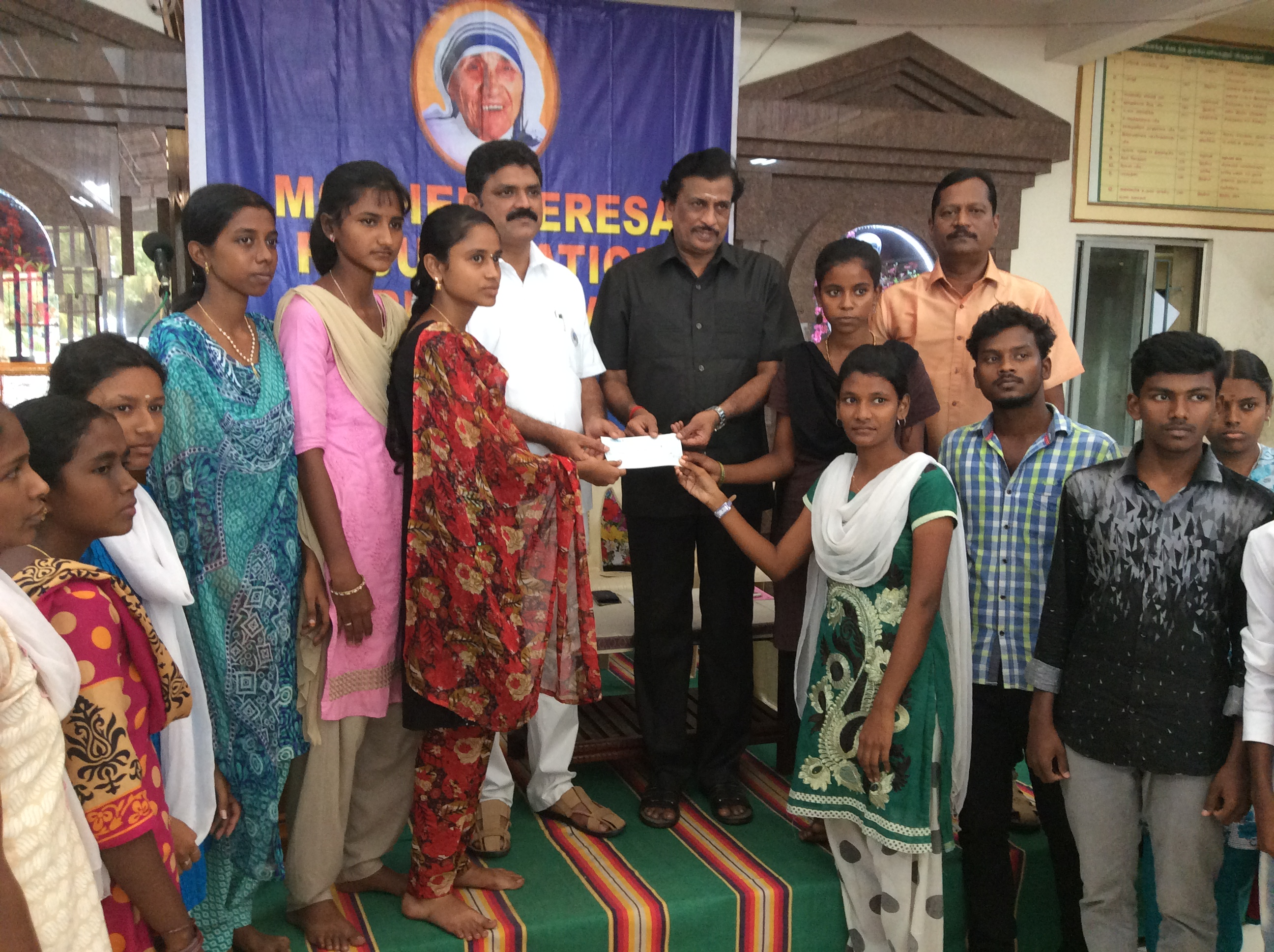 Chief guest handing over cheque on behalf of Foundation
