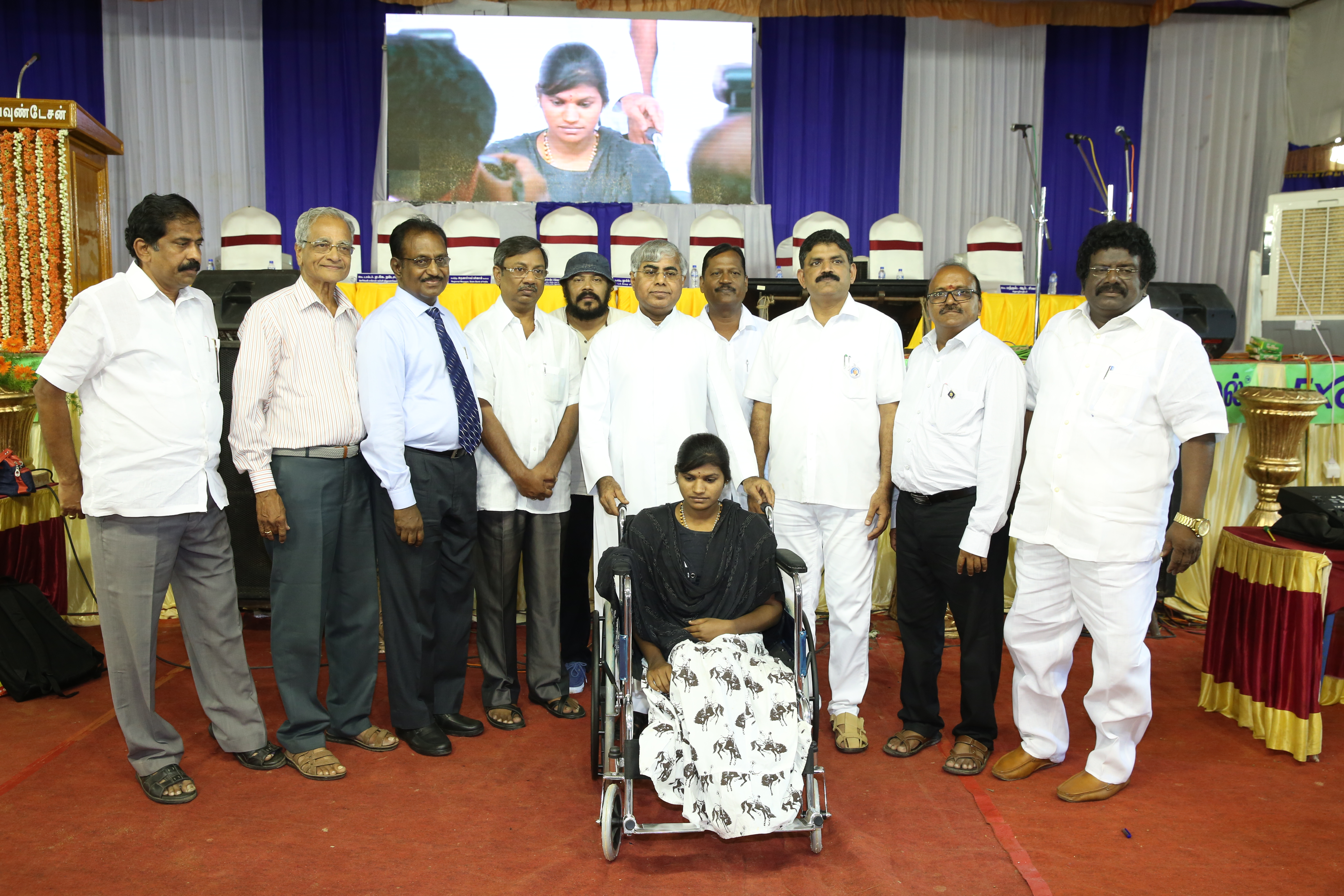 Rev. Fr. Vincent Chinnadurai presenting wheelchair
