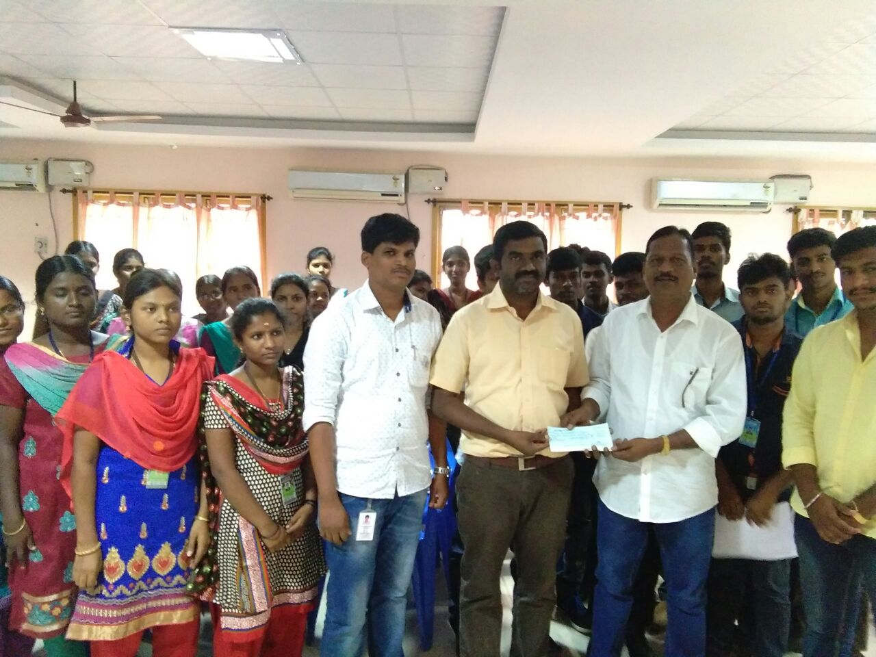 Thiru. H. Govindaraju, Trustee handing over cheque to the Director of Excel College of Engineering