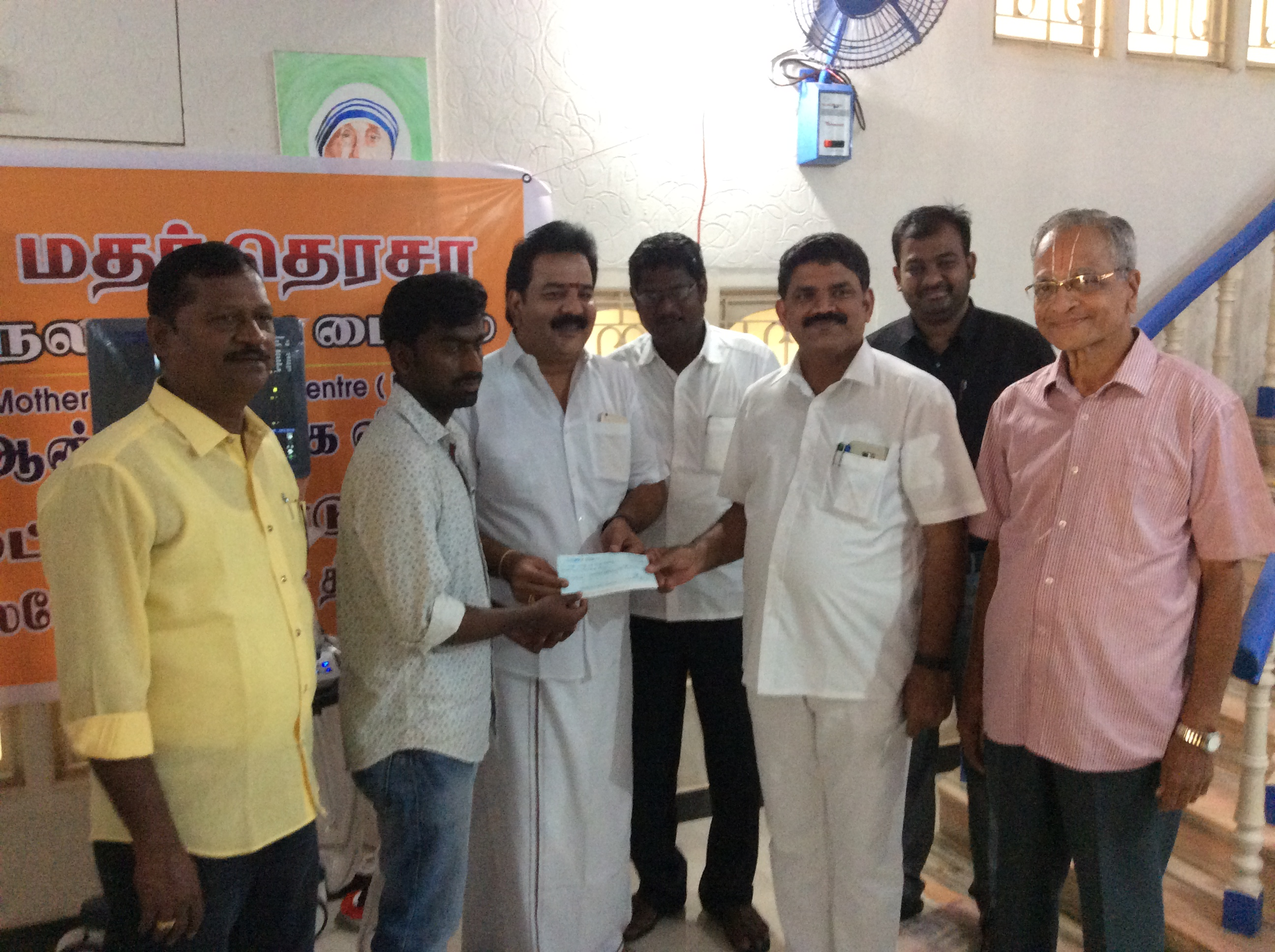 Selvan. D. Prasanth receiving cheque from chief guest