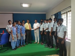 Chairman Handing over cheque to Principal