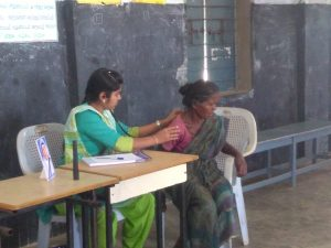 Doctor examining the patient during free rural medical camp.