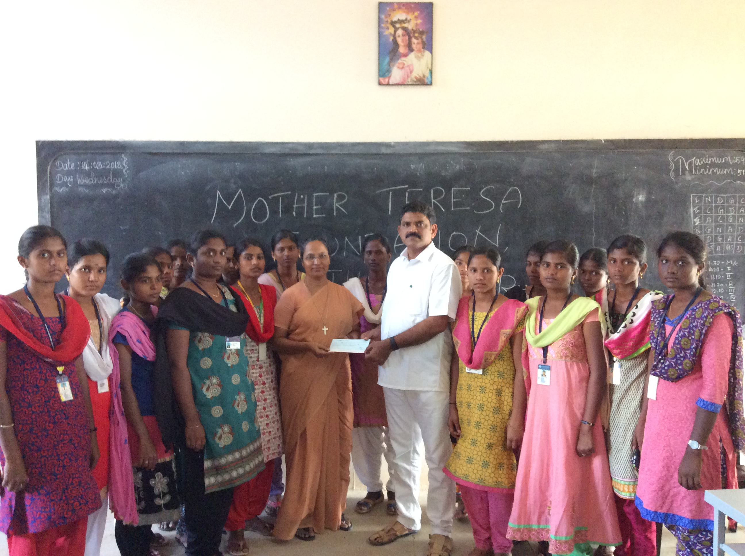 Chairman handing over cheque to Rev. Sr. Principal